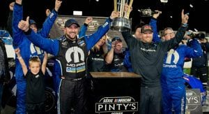 Andrew Ranger celebrates with his crew after clinching the NASCAR Pinty's Series title.