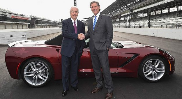 Roger Penske and Tony George shake hands on the frontstretch at Indianapolis Motor Speedway