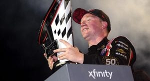 Tyler Reddick and the 2019 Xfinity Series championship trophy