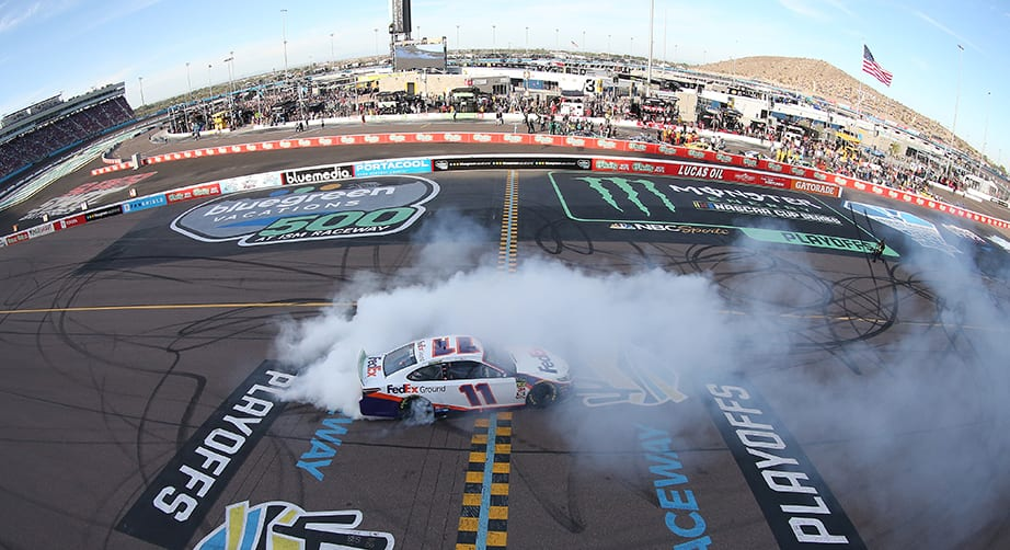 AVONDALE, ARIZONA - NOVEMBER 10: Denny Hamlin, driver of the #11 FedEx Ground Toyota, celebrates with a burnout after winning the Monster Energy NASCAR Cup Series Bluegreen Vacations 500 at ISM Raceway on November 10, 2019 in Avondale, Arizona. (Photo by Matt Sullivan/Getty Images) | Getty Images