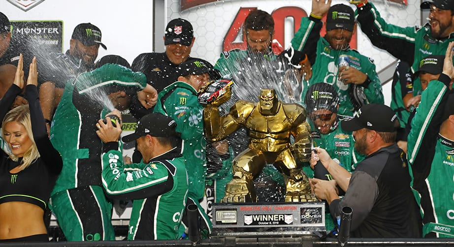 DOVER, DELAWARE - OCTOBER 06: Kyle Larson, driver of the #42 Clover Chevrolet, celebrates in Victory Lane after winning the Monster Energy NASCAR Cup Series Drydene 400 at Dover International Speedway on October 06, 2019 in Dover, Delaware. (Photo by Jeff Zelevansky/Getty Images)