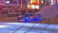 Larson uses neon lights, smoke bombs in Nashville burnout