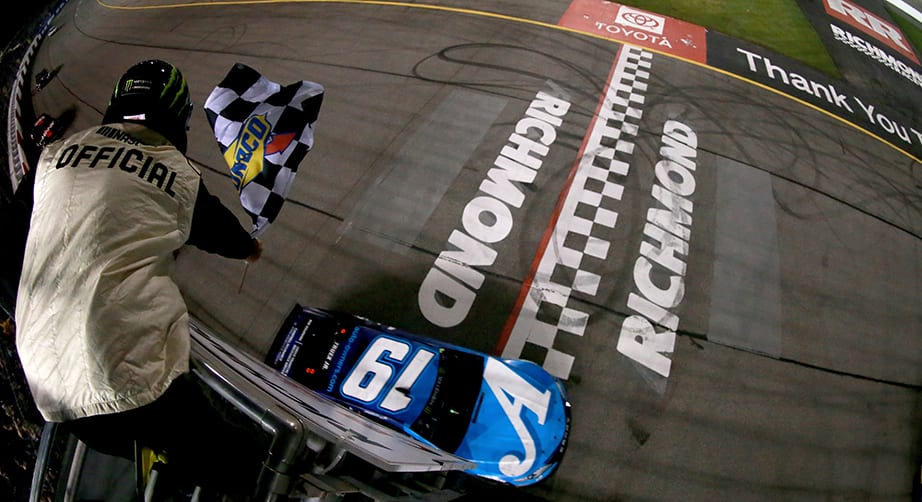 RICHMOND, VA - APRIL 13: Martin Truex Jr, driver of the #19 Auto Owners Insurance Toyota, takes the checkered flag to win the Monster Energy NASCAR Cup Series Toyota Owners 400 at Richmond Raceway on April 13, 2019 in Richmond, Virginia. (Photo by Sean Gardner/Getty Images) | Getty Images