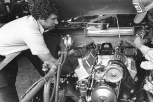 UNKNOWN: Waddell Wilson checks over the engine of Cale YarboroughÕs NASCAR Cup car in the garage area before a Cup race. A Wilson-built engine was the first to run a lap at over 200 mph at the Daytona International Speedway in qualifying for the 1983 Daytona 500. Unfortunately, driver Yarborough flipped on his second qualifying lap and the run was never considered official. Undaunted, the team rolled out a back-up car and won the 500 that year. (Photo by ISC Images and Archives via Getty Images)