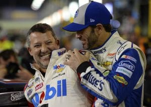 HOMESTEAD, FL - NOVEMBER 18: Tony Stewart (L), driver of the #14 Always a Racer/Mobil 1 Chevrolet, and Jimmie Johnson, driver of the #48 Lowe's Chevrolet, joke around on the grid during qualifying for the NASCAR Sprint Cup Series Ford EcoBoost 400 at Homestead-Miami Speedway on November 18, 2016 in Homestead, Florida. (Photo by Robert Laberge/Getty Images) | Getty Images