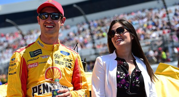RICHMOND, VA - APRIL 30:  Joey Logano, driver of the #22 Shell Pennzoil Ford, and his wife Brittany stand on the grid prior to the Monster Energy NASCAR Cup Series Toyota Owners 400 at Richmond International Raceway on April 30, 2017 in Richmond, Virginia.  (Photo by Jared C. Tilton/Getty Images) | Getty Images