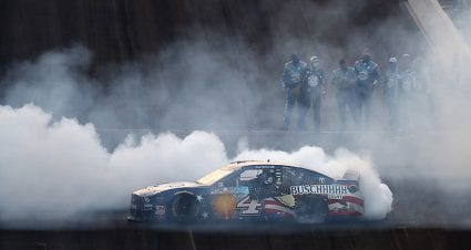 Kevin Harvick escapes in overtime, lands third Brickyard victory