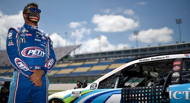 Bubba Wallace stands next to No. 43 car during national anthem at Kentucky