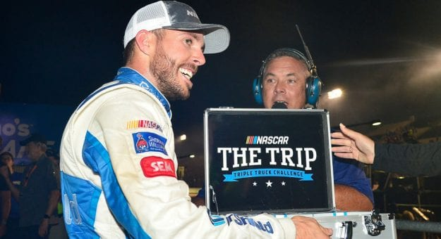 Ross Chastain with Triple Truck Challenge money suitcase