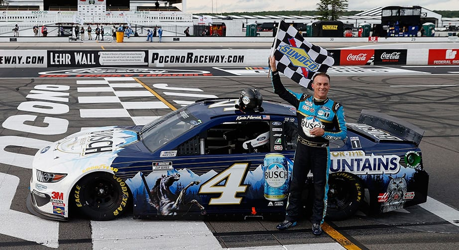 LONG POND, PENNSYLVANIA - JUNE 27: Kevin Harvick, driver of the #4 Busch Head for the Mountains Ford, celebrates after wining the NASCAR Cup Series Pocono Organics 325 in partnership with Rodale Institute at Pocono Raceway on June 27, 2020 in Long Pond, Pennsylvania. (Photo by Patrick Smith/Getty Images) | Getty Images