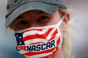BRISTOL, TENNESSEE - SEPTEMBER 19: a fan with NASCAR mask poses for a photo prior to the NASCAR Cup Series Bass Pro Shops Night Race at Bristol Motor Speedway on September 19, 2020 in Bristol, Tennessee. (Photo by Sean Gardner/Getty Images) | Getty Images