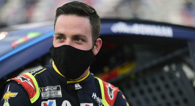 BRISTOL, TENNESSEE - SEPTEMBER 19: Alex Bowman, driver of the #88 Axalta Chevrolet, stands on the grid prior to the NASCAR Cup Series Bass Pro Shops Night Race at Bristol Motor Speedway on September 19, 2020 in Bristol, Tennessee. (Photo by Jared C. Tilton/Getty Images) | Getty Images